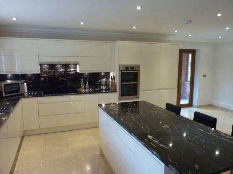 Handleless gloss kitchen cream in Attleborough