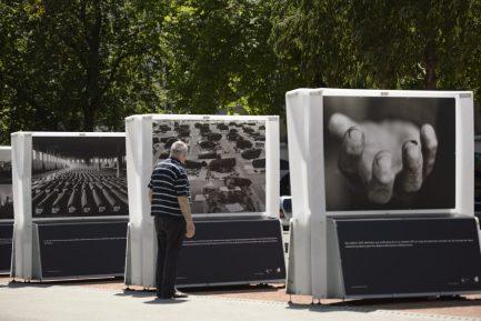 Photographs of Bosnian photographer Tarik Samarah are displayed during the exhibition