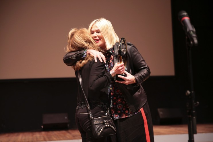 Honoree Mia Michaels hugs Presenter Nikki Feirt Atkins