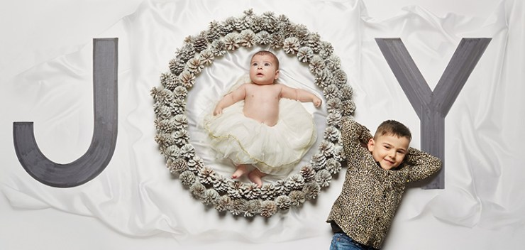 Two young children in a Christmas themed shoot.