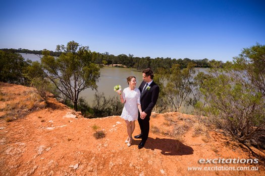 High angle photo of bride and groom with Murray River in background. Photographed by Excitations near Merbein