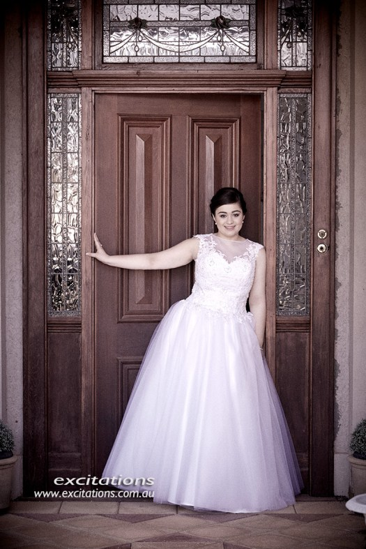 Beautiful Mildura Debutante poses at doorway to her home. Debutante photography by excitations Mildura photographers