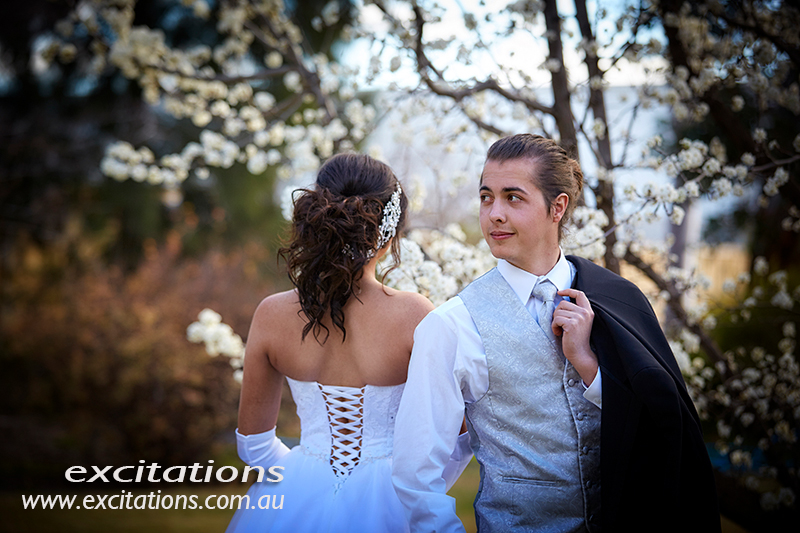 Debutantes on location. This time near Mildura beside a very large tree covered in spring blossom. Deb photos by Excitations, photographers Mildura/
