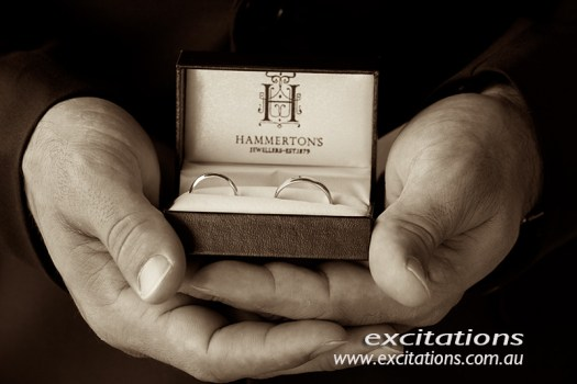 Close up of groom holding rings. Mildura wedding photography by excitations photographers Mildura.