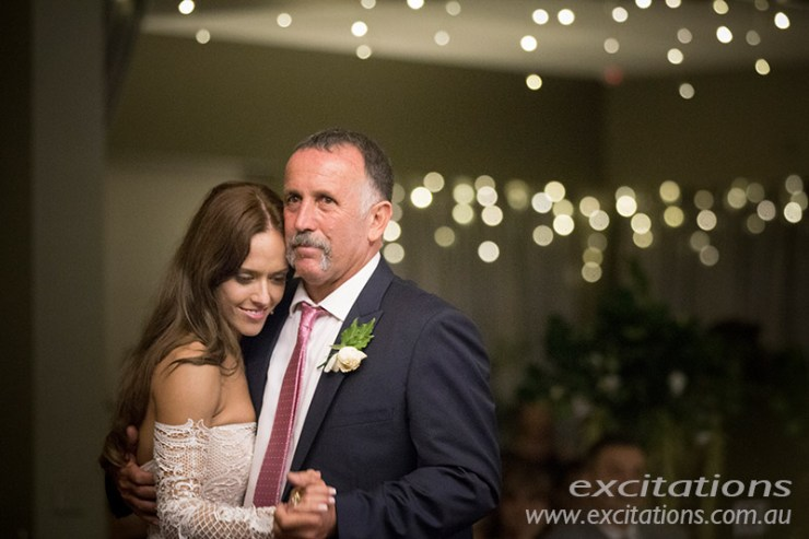 Father and Daughter Dance at wedding reception, out of focus lights in background.. Wedding pictures at reception by photographers in Mildura, Excitations.