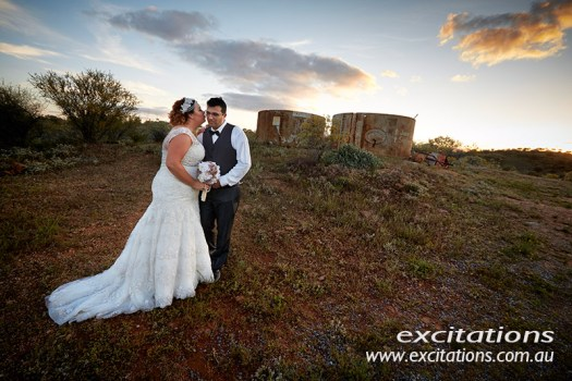 Rugged rustic wedding photography location with bride and groom at last light.