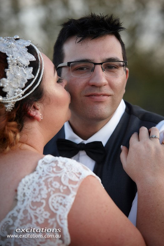 Bride kisses groom at Broken Hill wedding. Wedding pictures by Excitations Mildura photography.