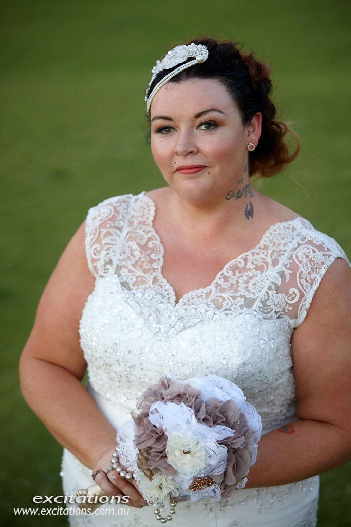 Half length portrait of bride standing on green golf course. Portrait of bide, Broken Hill. Photo by Excitations