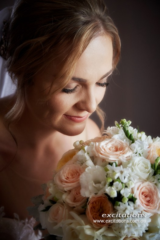 Mildura wedding photos by excitations, Mildura photographers. Formal closeup of bride with flowers.