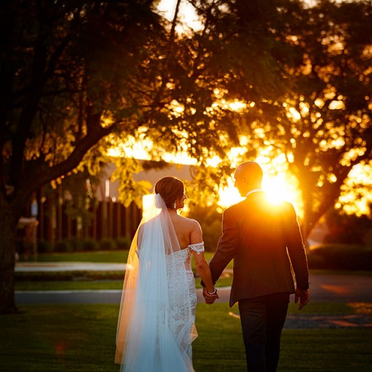 Half length walking away from camera. Bride and groom in Rio Vista gardens Mildura. Excitations Mildura wedding photographers.