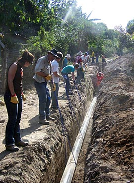 Photo of people working on wastewater system