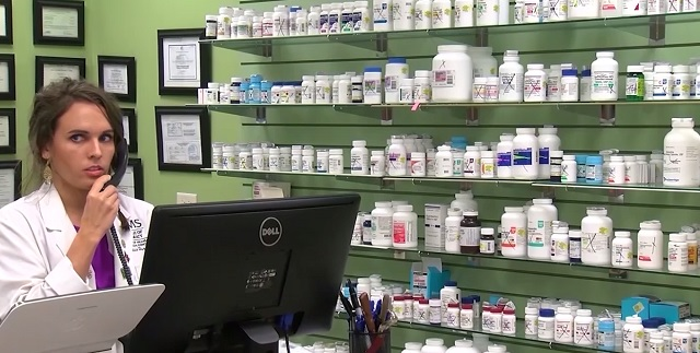pharmacist counter with medicine on shelves