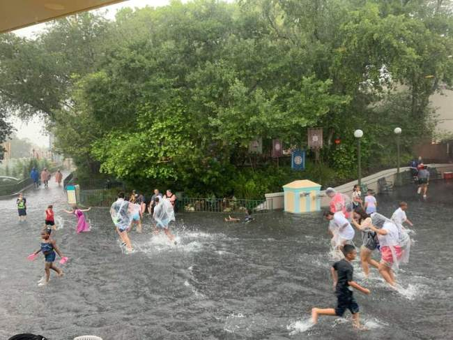 Disney guests swim in flooded Magic Kingdom streets (Credit: Cassie Claire Chase)