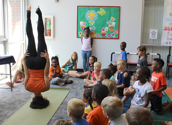 Children in Darlington become Little Yogis during summer program at the library