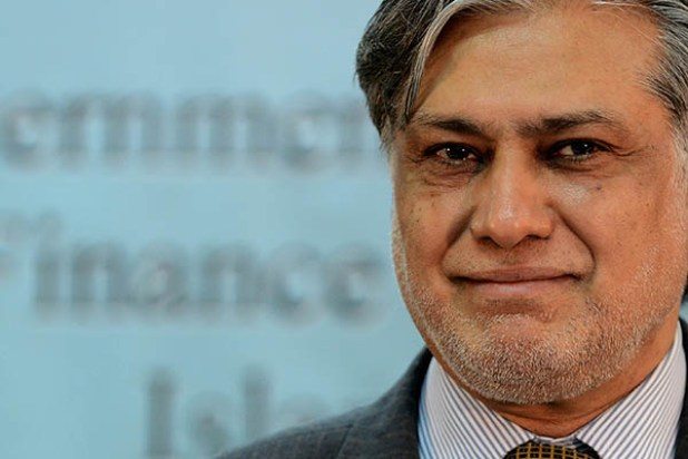 Pakistani Finance Minister, Ishaq Dar holds up a copy of the Economic Survey of Pakistan for the financial year 2012-13 at a press conference in Islamabad on June 11, 2013. The newly elected democratic government is all set to present its very first Federal Budget of about Pakistan rupees 3.4 trillion for the fiscal year 2013-14. AFP PHOTO/Farooq NAEEM