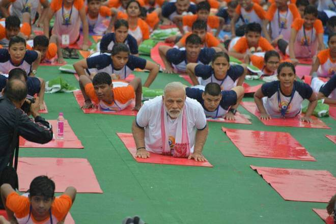 At the sprawling Ramabai Ambedkar Maidan, number of students, men and women perform along with Prime Minister Narendra Modi