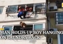 Man holds up boy hanging on fifth-floor laundry rack in China