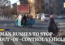 Man rushes to stop out-of-control vehicle in China
