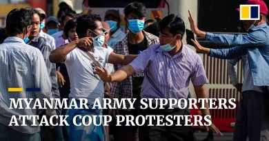 Knife-wielding supporters of Myanmar military attack anti-coup protesters in Yangon
