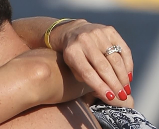 The bling ring! The 39-year-old flashed the diamond sparkler as she smooched her 21-year-old boyfriend by the water