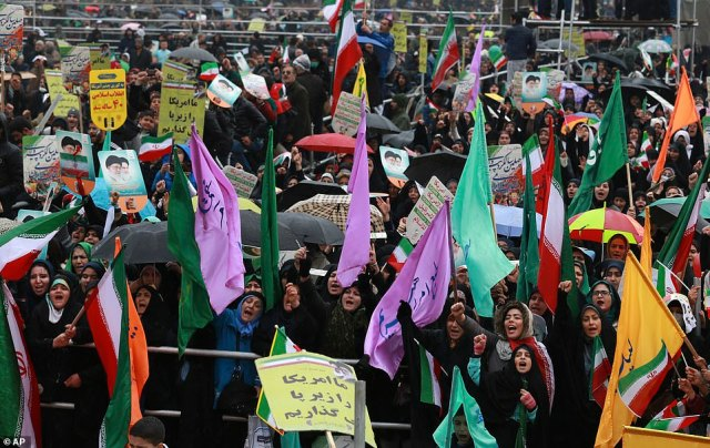 Large crowds were seen carrying Iranian flags and chanting 'Death to Israel, Death to America' - trademark chants of the revolution