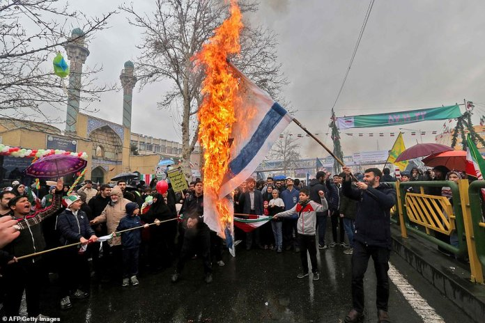 Iranians burn flags of Israel during commemorations of the 40th anniversary of Islamic Revolution in the capital Tehran