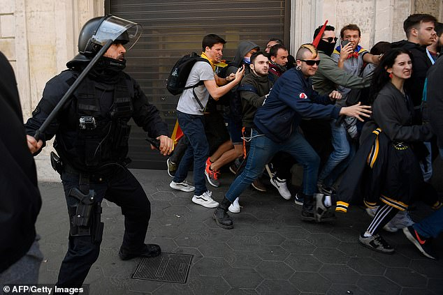 Police charge against protesters in Barcelona as demonstrations were held throughout Catalonia on Thursday
