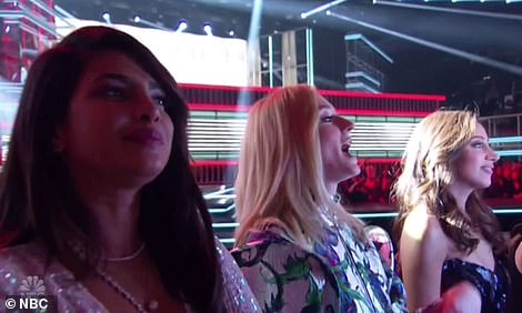 Loving life: Sophie appeared extremely animated as she called out to support her man from the audience