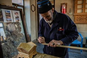 Carpenter Abdul Baqi helped with the restoration of Murad Khani. He also teaches carpentry and woodcarving to Afghanistan's younger generation.