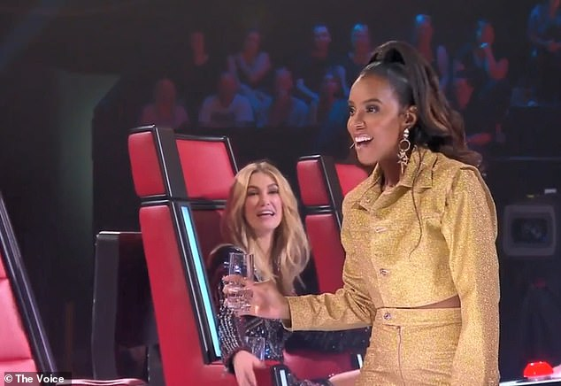 Just kids: Kelly Rowland and Delta Goodrem soaked Guy Sebastian's chair on The Voice on Monday as the coaches got competitive and threw water around