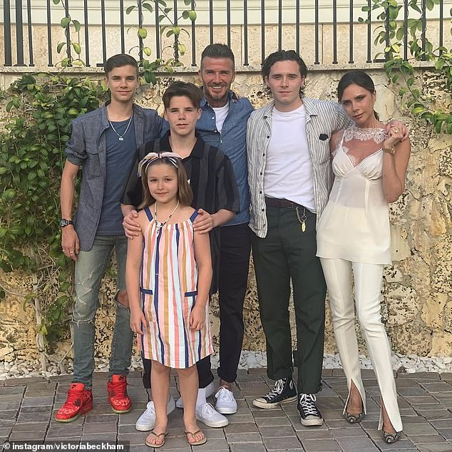 Full house: David shares Brooklyn, 20, Romeo, 16, Cruz, 14, and Harper, seven, with wife Victoria, 45