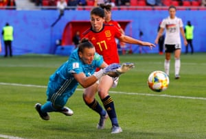 Spain's Lucia Garcia is beaten to the ball by Germany's keeper Almuth Schult.