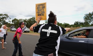 Pro-Adani supporters as environment activists arrive by convoy in Clermont, Queensland