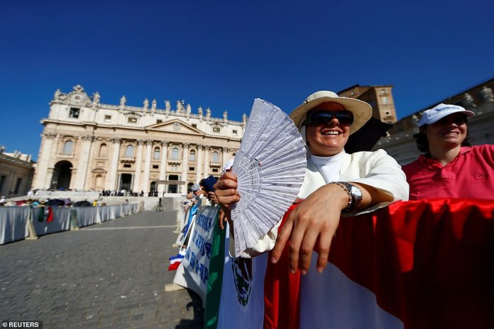 People brave heat to attend the general audience in St. Peter's Square at the Vatican on Wednesday