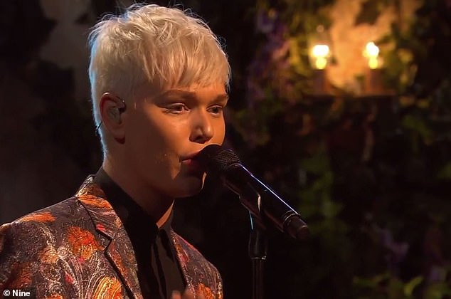 'I think they fell in love in with me as that 14 year-old boy and people want to hold onto that. I'm the same person, I have just grown,' he said. Pictured performing on The Voice