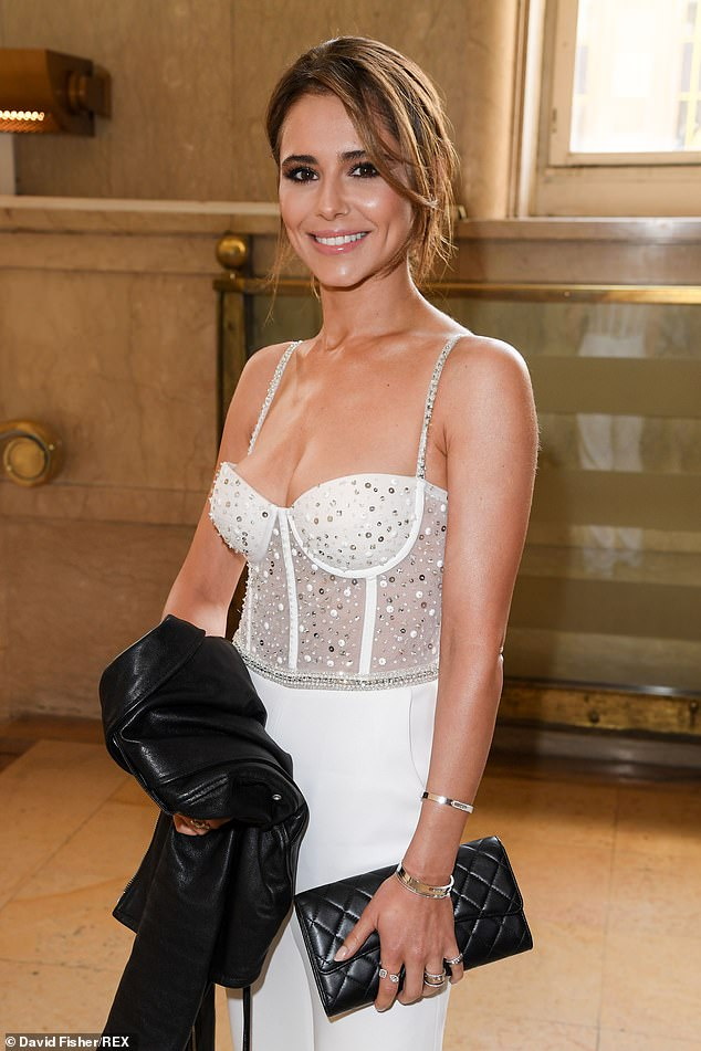 Incredible:Cheryl looked sensational as she finally arrived at the couture show clad in her all-white ensemble