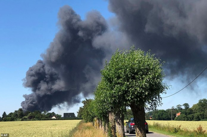 A fire burning on a scrap yard is seen in Duvendiek, Germany, on Sunday as sporadic fires broke out throughout the country during record temperatures