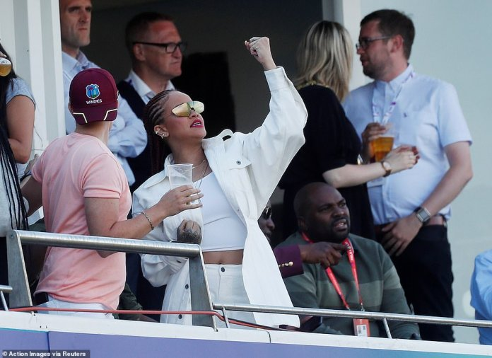 Headgear: While Rihanna opted for an all-white ensemble, her friend donned a Windies cap to show who she was supporting