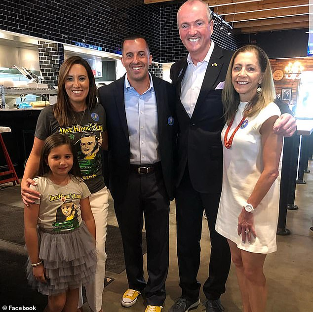 The new law boosts a patient's supply to a year, allows for home delivery and permits physician assistants to authorize medical cannabis. Pictured: Jake's family with Governor Phil Murphy (second from left 