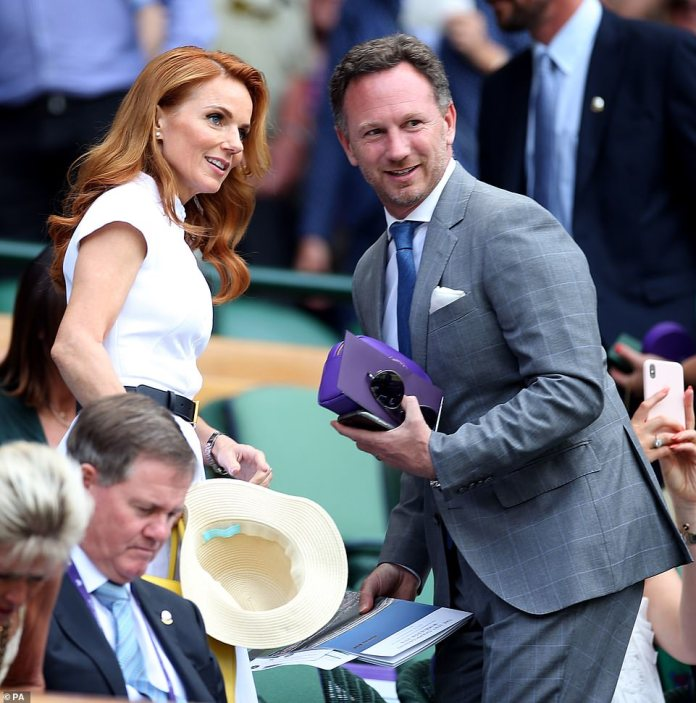 Spicing up Wimbledon: The Spice Girl, 46, looked demure in her chic white dress, which had a high-neckline and short sleeves to give her ensemble a glamorous flair