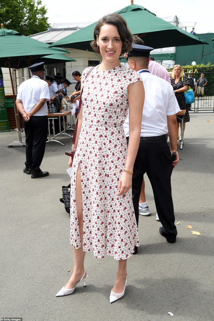 Chic: Phoebe Waller-Bridge, 33, was also on hand to support the tennis tournament, and she exuded elegance in a chic white dress, adorned with vibrant scarlet rose print