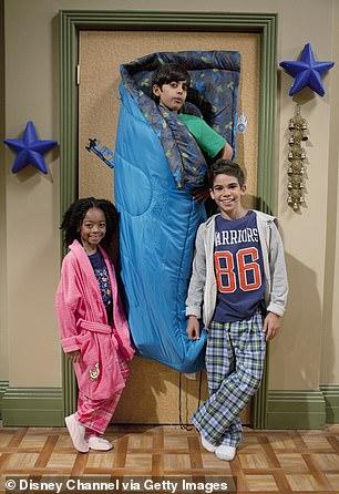 Aged 11, Cameron Boyce was cast on the hit Disney Channel show Jessie, alongside Skai Jackson and Karan Barr (pictured)