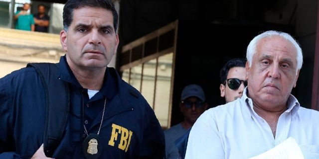 Suspect Tommaso Inzerillo, right, is taken into custody during an anti-mafia operation lead by the Italian Police and the FBI in Palermo, Southern Italy, Wednesday, July 17, 2019. Italian police and the FBI arrested 19 suspected Mafiosi in a joint operation Wednesday following an investigation which revealed alleged ties between Sicily's Cosa Nostra Mafia and New York's Gambino crime family.