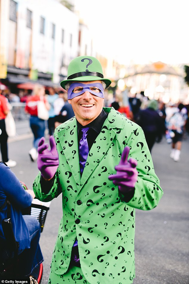 A cosplayer portrays the Riddler, a supervillain appearing in comic books published by DC Comics