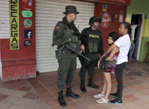 A police officer and a soldier patrolling the streets of Tibu, in Catatumbo. The military is the main presence of the state in the region.