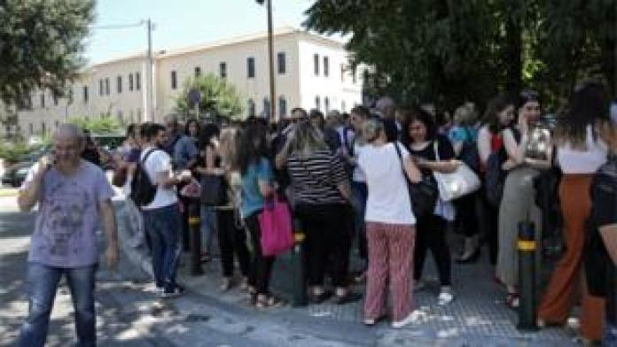 Citizens gather in an open area following an earthquake