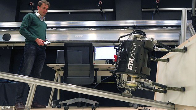 A dog-like robot being developed to hop across complex terrain on other planets has been used to play a live-action game of ping pong in its latest phase of testing.Scientists mounted the SpaceBok sideways onto a free-floating platform to mimic zero gravity (pictured)