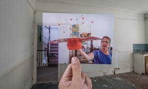 Dorothea holding up Aram's 'Monopoly Hat' school art project in her studio, 1998.