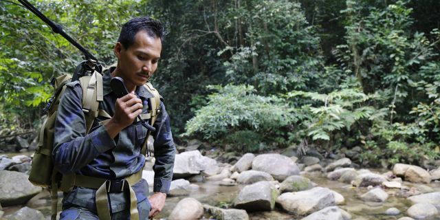 The remains were reportedly found by a hiker who claimed that the body appeared to have been dumped by the stream after the initial search parties failed to make the discovery. (AP Photo/Lai Seng Sin)