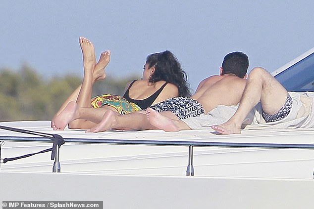 Relaxed: Shanina crossed her legs and raised them in the air as she looked out to sea